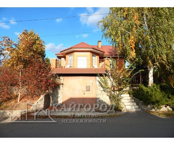 Продам прекрасный дом у озера в черте города